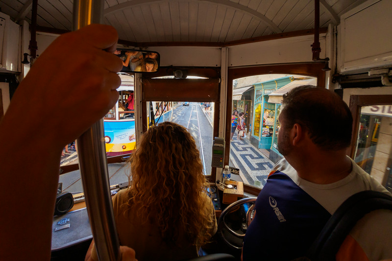 Riding the always crowded trolly to the top of the hill in Lisbon.
