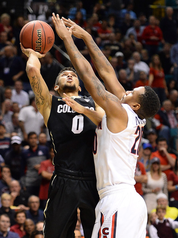 . LAS VEGAS, NV - MARCH 14:  Askia Booker #0 of the Colorado Buffaloes shoots against Jordin Mayes #20 of the Arizona Wildcats during a semifinal game of the Pac-12 Basketball Tournament at the MGM Grand Garden Arena on March 14, 2014 in Las Vegas, Nevada. Arizona won 63-43.  (Photo by Ethan Miller/Getty Images)