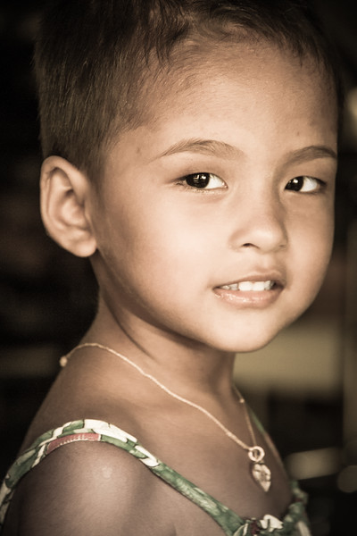 Lovely portrait of a little girl captured in the Old Town of Phuket.