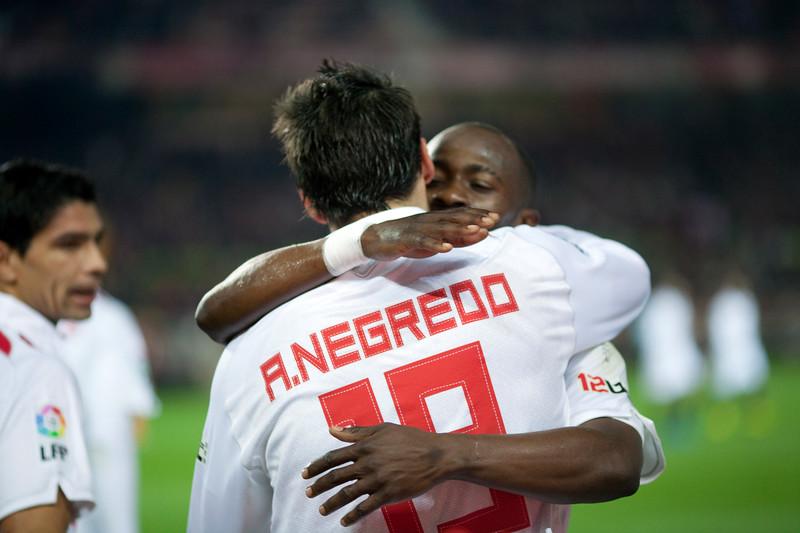 Zokora and Negredo hugging after a goal scoring. Spanish Liga game between Sevilla FC and Valencia CF. Sanchez Pizjuan stadium, Seville, Spain, 31 January 2010