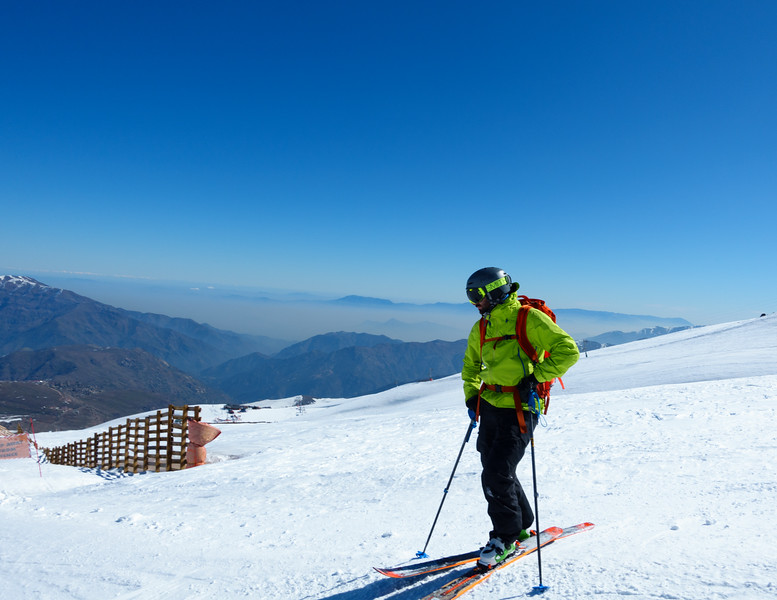 Marc resting while ripping groomers at La Parva. Day 4. Santiago is in the smog below.
