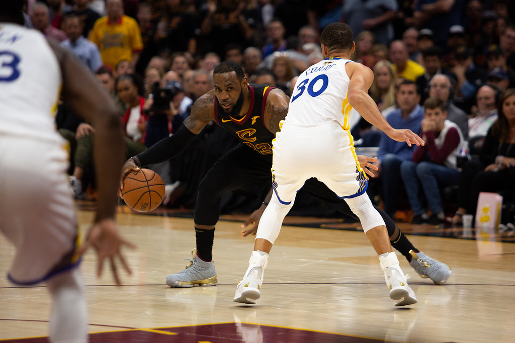 . LeBron James of the Cleveland Cavaliers looks to drive on Steph Curry during game 3 of the 2018 NBA Finals on June 6, 2018.  Michael Johnson/ The News Herald