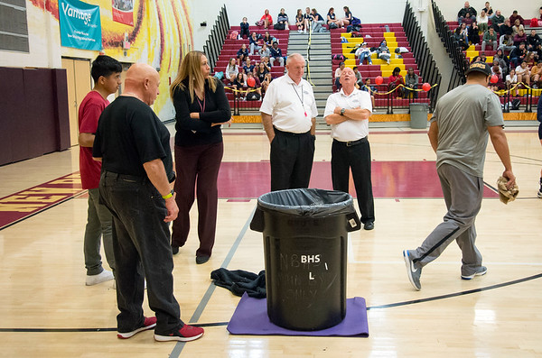 10/30/19 Wesley Bunnell | StaffrrCoaches and volleyball officials stand around as a trash can catches rain water which had been dripping onto the New Britain High School gym floor. The leak caused the postponement of the girls volleyball game vs Rocky Hill during the second set with the game to be continued tomorrow at Rocky Hill High School at 4p.m. as more rain is in the forecast.