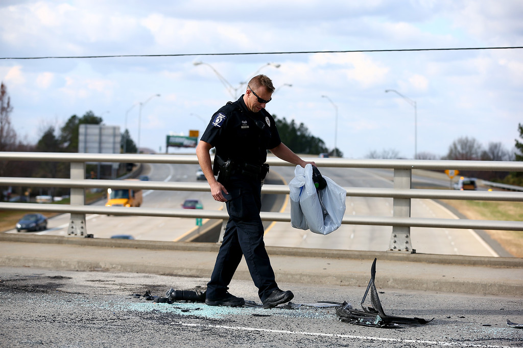 . A police officer looks over the scene after a pickup truck belonging to quarterback Cam Newton of the Carolina Panthers was involved in a roll over accident in front of Bank of America Stadium on December 9, 2014 in Charlotte, North Carolina. Newton was transported from the scene in an ambulance after he was involved in a car accident.  (Photo by Streeter Lecka/Getty Images)