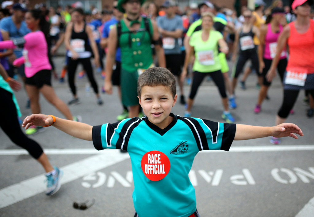 . A young athlete warms up at the starting area of the annual Wharf to Wharf race in Santa Cruz on Sunday. (Kevin Johnson -- Santa Cruz Sentinel)