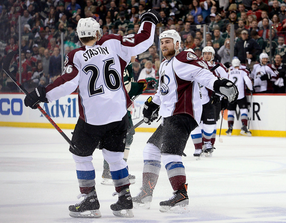 . Colorado Avalanche center Paul Stastny (26) celebrates his goal with Colorado Avalanche center Ryan O\'Reilly (90) on a short handed power play during the first period April 28, 2014 in Game 6 of the Stanley Cup Playoffs at Xcel Energy Center.  (Photo by John Leyba/The Denver Post)