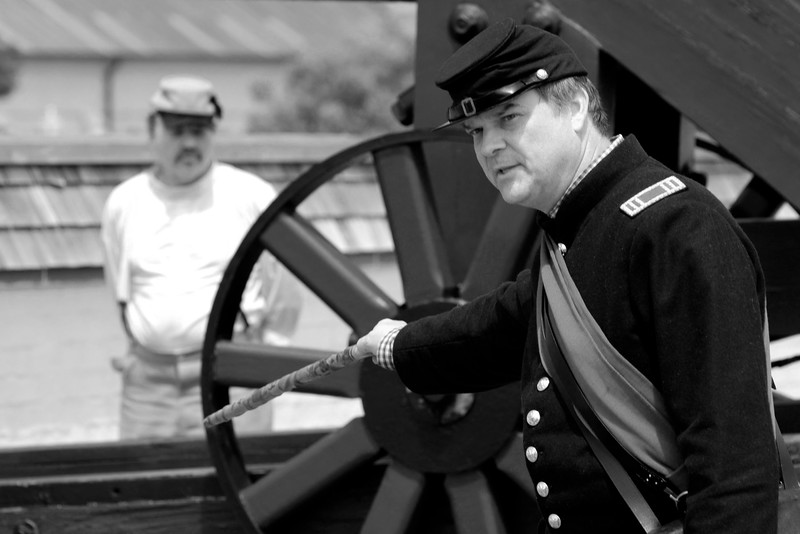 Reenactor Colonel Jeff Ulmer explains how the artillery members fire this Model 1841 32-pound Smooth Bore canon at Ft. Moultrie in Sullivan's Island, South Carolina on Monday, April 11, 2011. ..The 150th Anniversary of the Firing on Ft. Sumter was commemorated with lectures, performances, demonstrations, and a living history throughout the area on James Island, Charleston, Mt. Pleasant, and Sullivan's Island during the week from April 8-14, 2011. Photo Copyright 2011 Jason Barnette