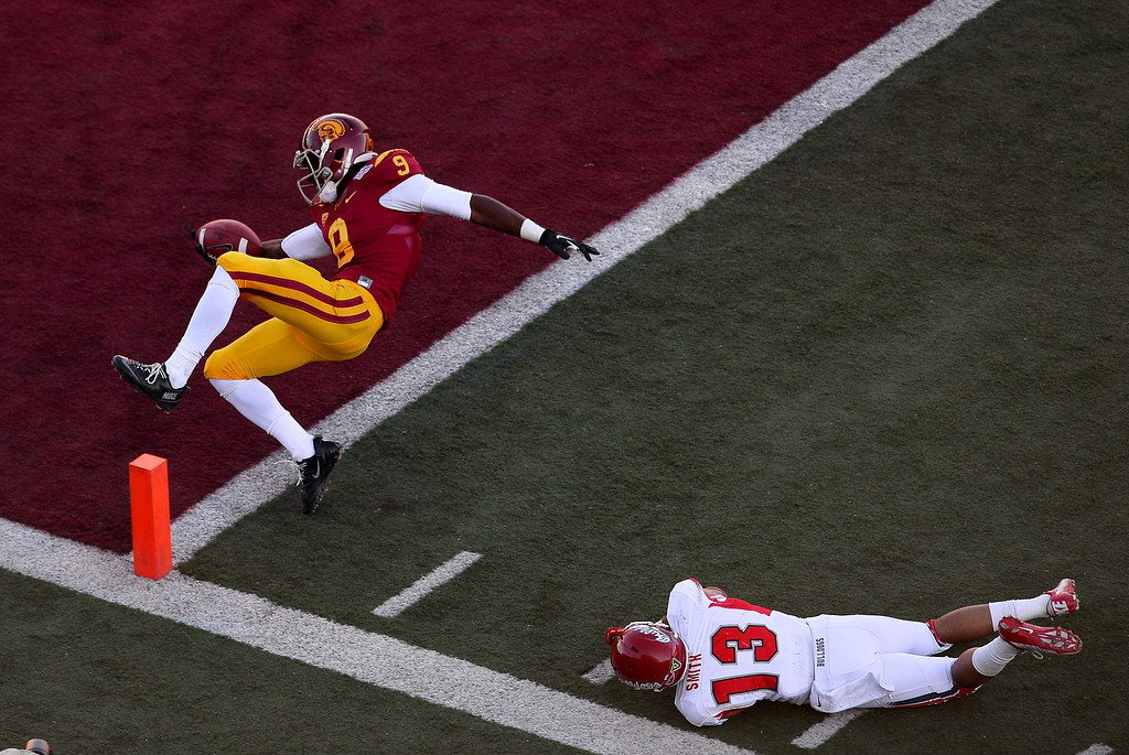 . LAS VEGAS, NV - DECEMBER 21:  Marqise Lee #9 of the USC Trojans gets into the end zone for a touchdown ahead of Derron Smith #13 of the Fresno State Bulldogs during the Royal Purple Las Vegas Bowl at Sam Boyd Stadium on December 21, 2013 in Las Vegas, Nevada.  (Photo by Ethan Miller/Getty Images)