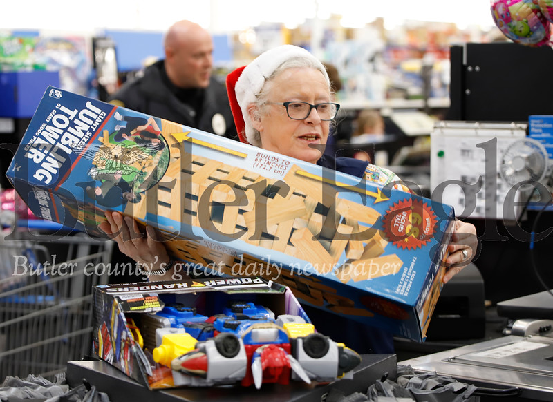 Walmart cashier Linda Desmond rings up toy purchases at Friday's Butler Area School District, Walmart Shop with a Cop event. Seb Foltz/Butler Eagle