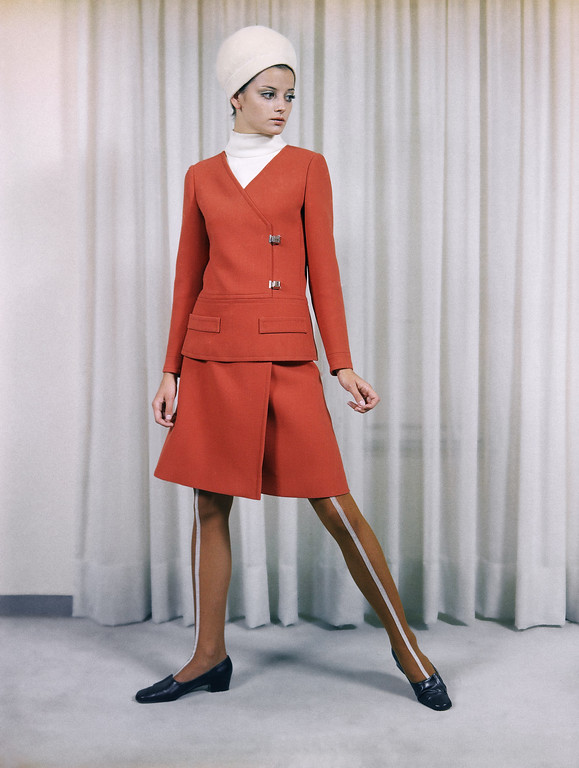 . A tailored dress of rust-red wool, worn with a white jersey bodice, a creation by the Irene Galitzine fashion house of Rome, July 23, 1968, presented at its show of its fall and winter collection on July 17. The small hat is by the Canessa house of Rome. (AP Photo/Mario Torrisi)