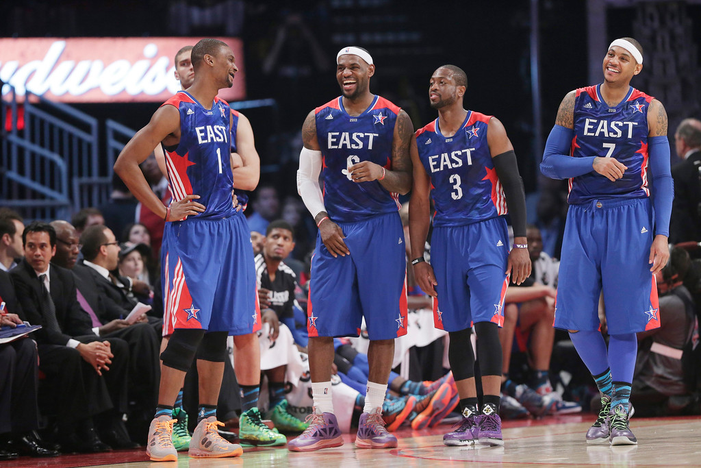 . From left, East Team\'s Chris Bosh of the Miami Heat, LeBron James of the Miami Heat, Dwyane Wade of the Miami Heat and Carmelo Anthony of the New York Knicks share a moment during the first half of the NBA All-Star basketball game against the West Team Sunday, Feb. 17, 2013, in Houston. (AP Photo/Eric Gay)