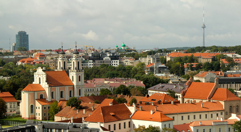 The 18th-century Baroque St. Catherine's Church (left) and TV Tower (right) -Vilnius, Lithuania