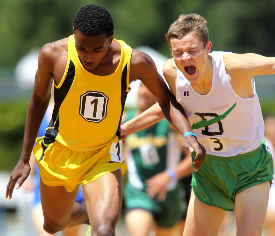 . Bishop O\'Dowd\'s Eugene Hamilton III, from left, edges out Sir Francis Drake\'s Clayton Hutchins for the win in the boys 1600 meter final at the North Coast Section Meet of Champions at Cal\'s Edwards Stadium in Berkeley, Calif., on Saturday, May 25, 2013. (Anda Chu/Bay Area News Group)