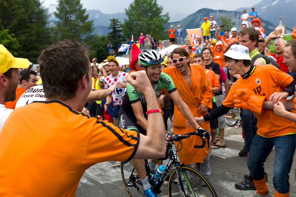 . Dutch cycling fans cheers as Sep Vanmarcke of Belgium passes curve number 7, also known as the Dutch curve during the eighteenth stage of the Tour de France cycling race over 172.5 kilometers (107.8 miles) with start in Gap and finish in Alpe-d\'Huez, France, Thursday July 18, 2013. (AP Photo/Thibault Camus)