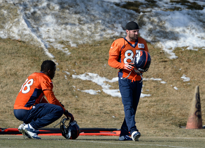 . Denver Broncos wide receiver Demaryius Thomas (88) and Denver Broncos wide receiver Wes Welker (83) work through drills during practice January 9, 2014 at Dove Valley (Photo by John Leyba/The Denver Post)