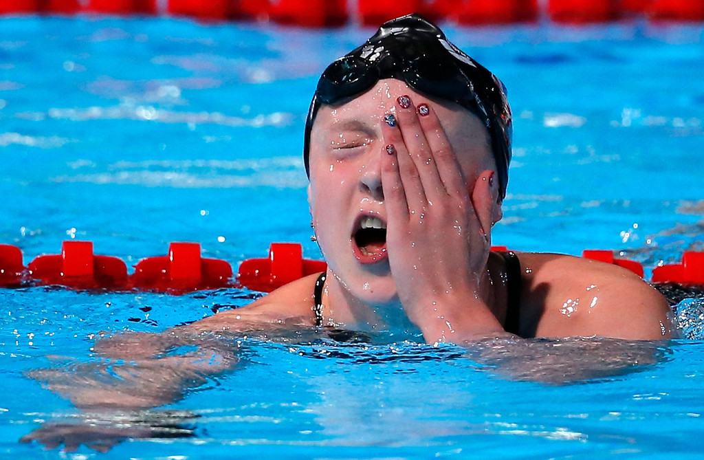 . Katie Ledecky of the United States reacts after winning the gold medal in the Women\'s 800m freestyle final at the FINA Swimming World Championships in Barcelona, Spain, Saturday, Aug. 3, 2013.  Ledecky won in a new world record time of 8:13.86. (AP Photo/Daniel Ochoa de Olza)