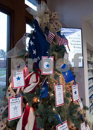 11/8/17 Wesley Bunnell | Staff A Veterans' Day tree was set up in the Berlin-Peck Library by the Kensington Garden Club featuring the names of service members.