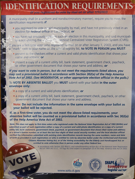 08/14/18  Wesley Bunnell | Staff  ID requirements posted at Slade Middle School voting station on Tuesday evening.