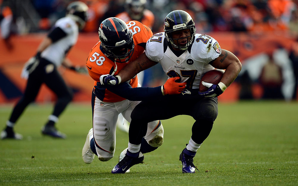 Description of . Denver Broncos outside linebacker Von Miller (58) takes down Baltimore Ravens running back Ray Rice (27) in the first half.  The Denver Broncos vs Baltimore Ravens AFC Divisional playoff game at Sports Authority Field Saturday January 12, 2013. (Photo by Hyoung Chang,/The Denver Post)