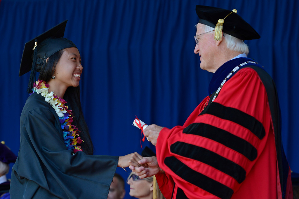 . Saint Mary\'s College president James A. Donahue shakes hands Malina Strohecker, of San Jose, as she gets her diploma during the 2014 Saint Mary\'s College commencement ceremony in Moraga, Calif., on Saturday, May 24, 2014. A total of 758 students graduated making this the largest graduating class in school history. (Jose Carlos Fajardo/Bay Area News Group)