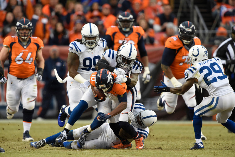 . Emmanuel Sanders (10) of the Denver Broncos is taken down by the Colts defense in the second quarter. The Denver Broncos played the Indianapolis Colts in an AFC divisional playoff game at Sports Authority Field at Mile High in Denver on January 11, 2015. (Photo by Joe Amon/The Denver Post)