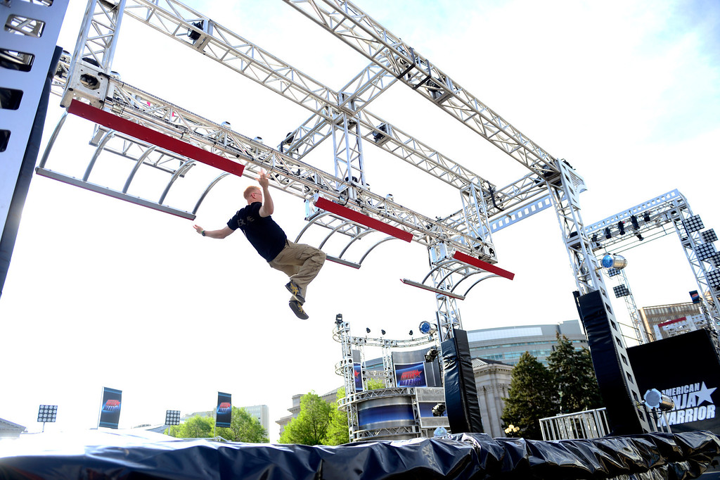 . Course tester Sam Bukowski jumps between rungs before the tryout for American Ninja Warrior Denver on May 19, 2013. (Photo by AAron Ontiveroz/The Denver Post)