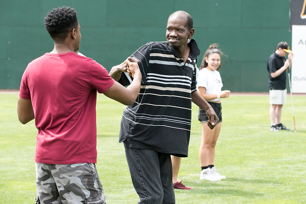 07/02/19 Wesley Bunnell | Staff The New Britain Bees welcomed group home members to New Britain Stadium as part of the Beautiful Lives Project on Tuesday July 2, 2019.Bees players and coaches played wiffle ball games on the outfield grass with the participants. Wilbur Frazier from CCARC fist bumps a counselor after reaching first base.