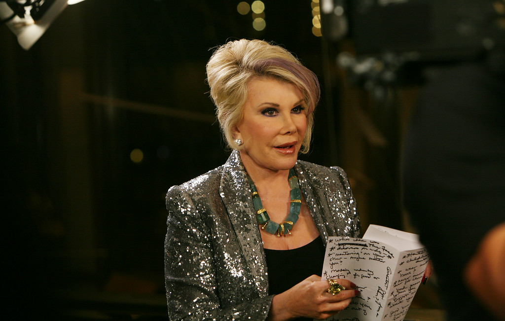 . Joan Rivers prepares for an interview at the Zac Posen Spring 2013 Runway Show on Sunday, Sept. 9, 2012 in New York. (Photo by Amy Sussman/Invision/AP Images)