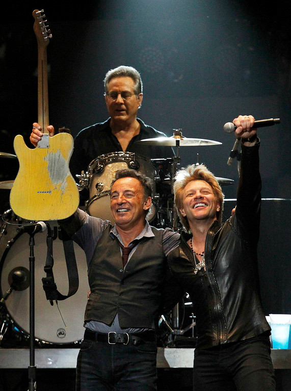 """. Singer Bruce Springsteen performs with Jon Bon Jovi (R) and drummer Max Weingberg during the \""""12-12-12\"""" benefit concert for victims of Superstorm Sandy at Madison Square Garden in New York December 12, 2012. REUTERS/Lucas Jackson"""