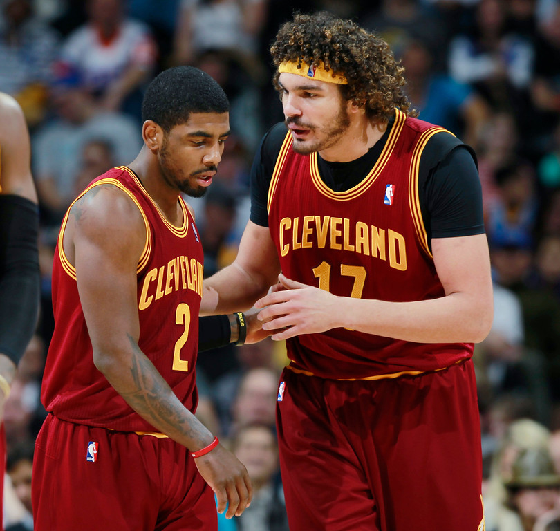 . Cleveland Cavaliers guard Kyrie Irving, left, confers with center Anderson Varejao, of Brazil, between plays against the Denver Nuggets in the fourth quarter of the Cavaliers\' 117-109 victory in an NBA basketball game in Denver on Friday, Jan. 17, 2014. (AP Photo/David Zalubowski)