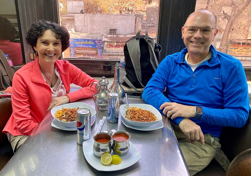 One thing we definitely loved about Egypt was the food. Here we are with one of our favorite dishes: Kushari, a mixed dish of macaroni, rice, chickpeas and lentils with garlic vinegar, spicy tomato sauce, and crispy fried onions on top…YUMM-O!