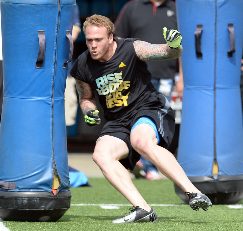 . Cassius Marsh demonstrates his skills during UCLA Football Pro Day at Spaulding Field on the UCLA campus Tuesday, March 11, 2014. (Photo by Hans Gutknecht/Los Angeles Daily News)