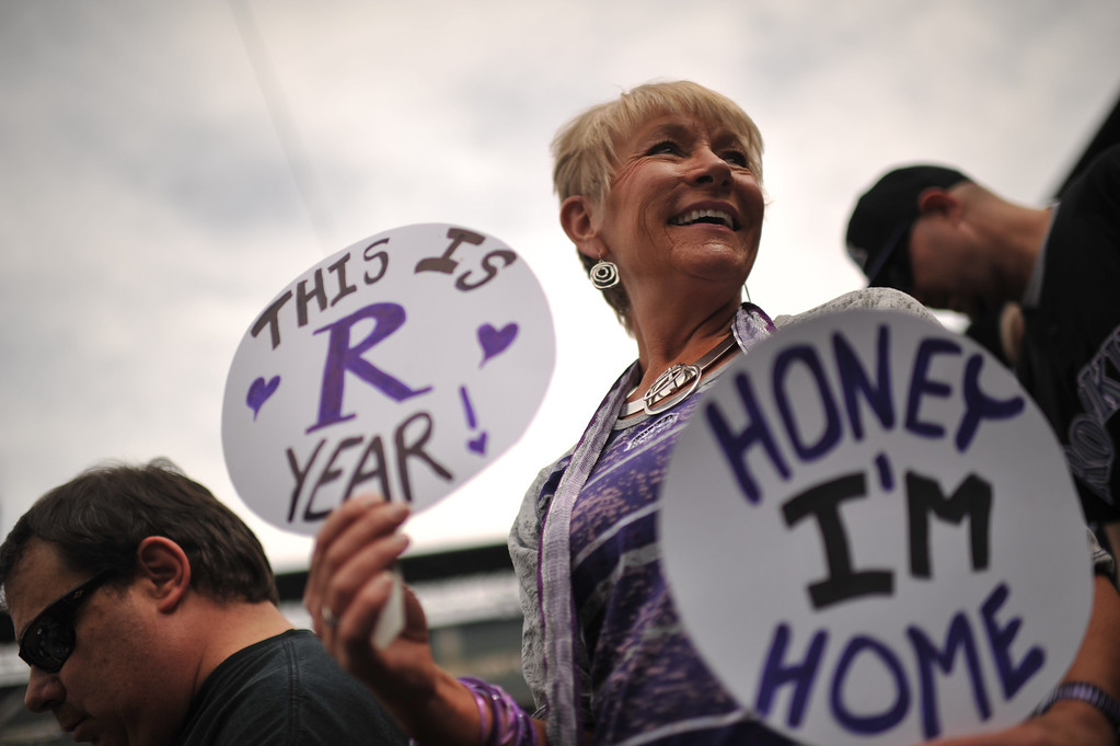 . Peggy Cowan from Florissant watches batting practice before the game. The Colorado Rockies took on the San Diego Padres on Opening Day at Coors Field in Denver, Colorado. (Photo by Hyoung Chang/The Denver Post)