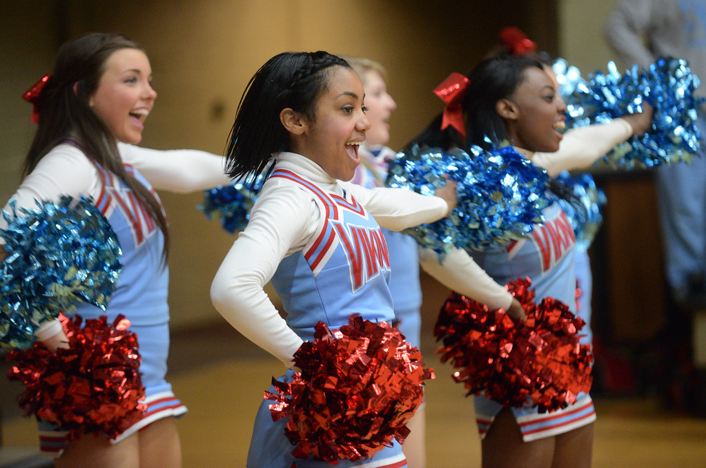. Duncan Scott/DScott@News-Herald.com VASJ\'s cheerleaders urge their team on durng a fourth quarter timeout. VASJ defeated Youngstown Ursuline 69-60 March 15 in the Division III regional final at Canton Memorial Fieldhouse.