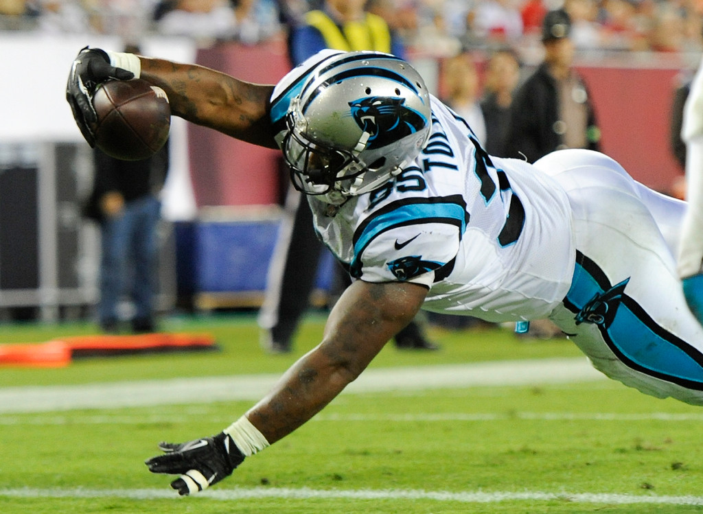 . Carolina Panthers fullback Mike Tolbert dives over the goal line on a 3-yard touchdown pass play against the Tampa Bay Buccaneers during the second half of an NFL football game in Tampa, Fla., Thursday, Oct. 24, 2013. (AP Photo/Brian Blanco)