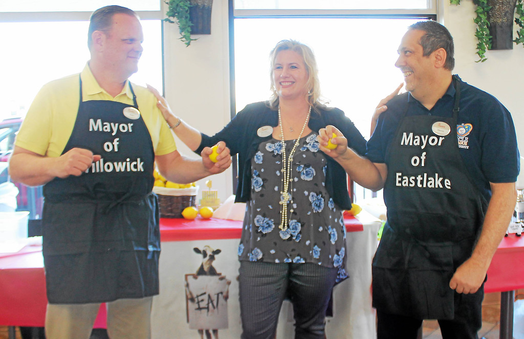 . Kristi Garabrandt � The News-Herald <br> Chick-Fil-A Willoughby owner Billie Federer stands with Willowick Mayor Rich Regovich and Eastlake Mayor Dennis Morley as they prepare to battle it out in the first annual lemon squeeze competition at Chick-Fil-A Willoughby to raise funds for The Miracle League on March 30, 2017.
