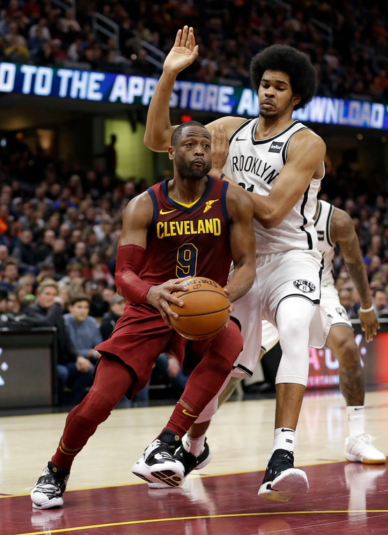 . Cleveland Cavaliers\' Dwyane Wade (9) drives against Brooklyn Nets\' Jarrett Allen (31) in the second half of an NBA basketball game, Wednesday, Nov. 22, 2017, in Cleveland. (AP Photo/Tony Dejak)