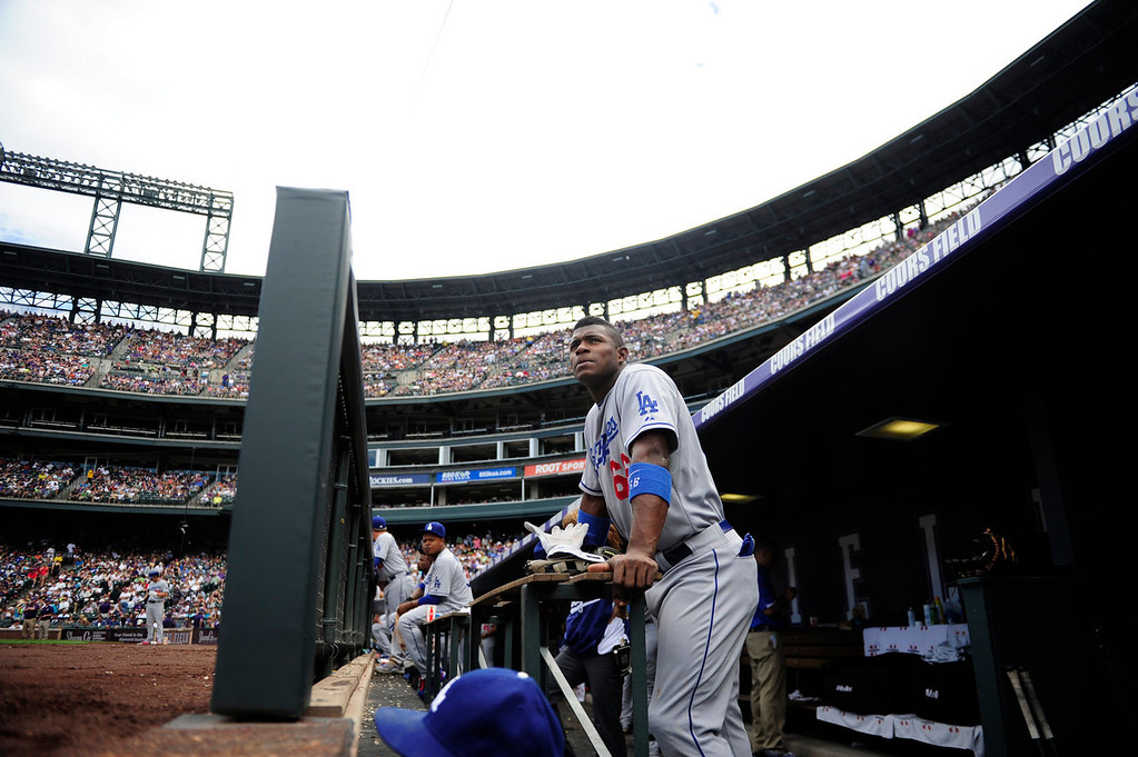 . Yasiel Puig (66) of the Los Angeles Dodgers watches the action against the Colorado Rockies during the action in Denver on Monday, September 2, 2013. The Colorado Rockies hosted the Los Angeles Dodgers at Coors Field.   (Photo by AAron Ontiveroz/The Denver Post)