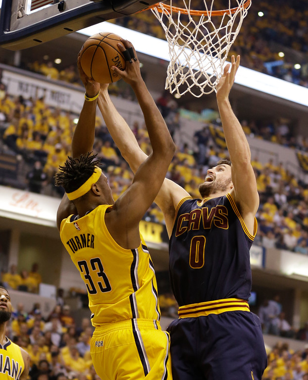 . Indiana Pacers\' Myles Turner (33) and Cleveland Cavaliers\' Kevin Love battle for a rebound during the first half in Game 3 of a first-round NBA basketball playoff series, Thursday, April 20, 2017, in Indianapolis. (AP Photo/Michael Conroy)