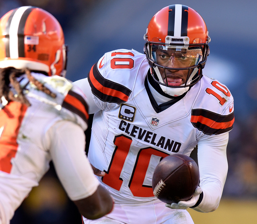 . Cleveland Browns quarterback Robert Griffin III (10) hands off during the second half of an NFL football game against the Pittsburgh Steelers in Pittsburgh, Sunday, Jan. 1, 2017. (AP Photo/Don Wright)
