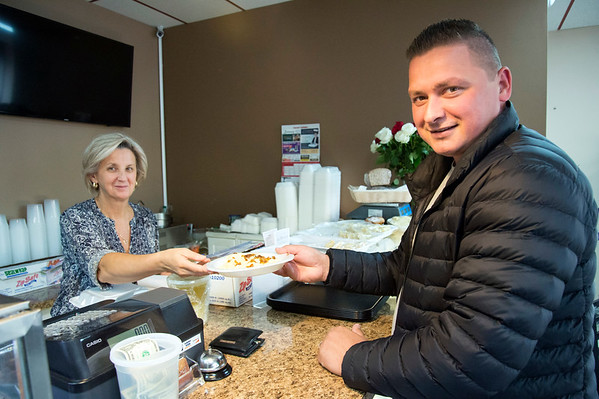 10/08/19 Wesley Bunnell | StaffrrElzbieta Kujawa , co owner of Euro Plate Restaurant located on Broad St, serves customer Alex Skrzypiski a plate of pierogi with his lunch on Tuesday afternoon. Tuesday was national pierogi day.