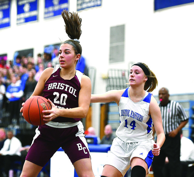 1/23/2020 Mike Orazzi | Staff Bristol Central's Gwen Torreso (20) and Bristol Eastern's Alyssa Kehler (14) during Thursday night's girls basketball game at Bristol Eastern.