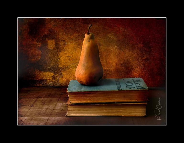 Bosc pear on books