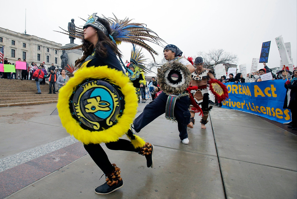 . Aztec dancers perform during a May Day rally and march to the Minnesota State Capitol to call for immigration reform Wednesday, May 1, 2013 in St. Paul, Minn. (AP Photo/Jim Mone)