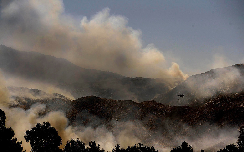 . Copters make drops on the Silver Fire as seen from W. Lincoln Street as  it burns in the mountains south of Banning August 8, 2013.   GABRIEL LUIS ACOSTA/STAFF PHOTOGRAPHER.