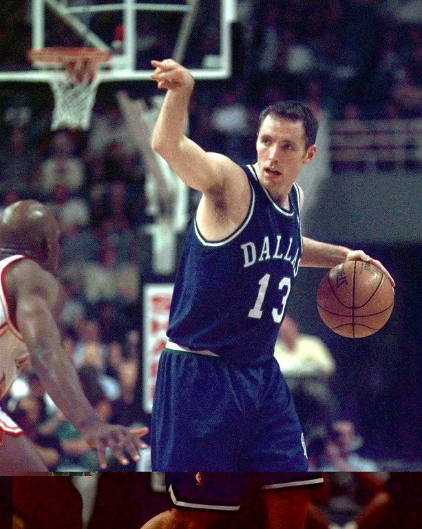 . Dallas Mavericks guard Steve Nash (13) directs the offense against the Miami Heat at Miami Arena in Miami Wednesday, April 7, 1999.  (AP Photo/Chris Matula)