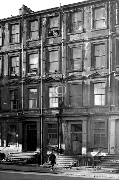 46-50 Abbotsford Place.    I don't think it was still formally occupied at this late date - were they squatters at the top floor window? or urban explorers?  In fact, as I've been informed, this was at the time a refuge for women with abusive husbands.    December 1975