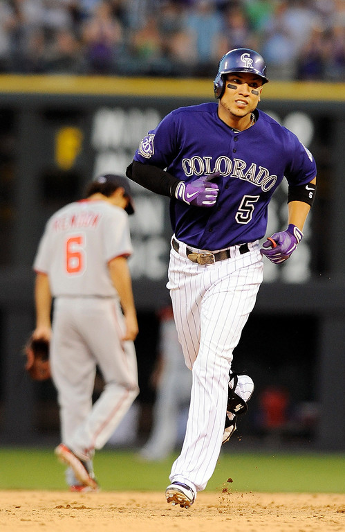 . Colorado Rockies Carlos Gonzalez rounds the bases after hitting a three-run home run in the fifth inning of a baseball game against the Washington Nationals on Tuesday, June 11, 2013 in Denver. (AP Photo/Chris Schneider)