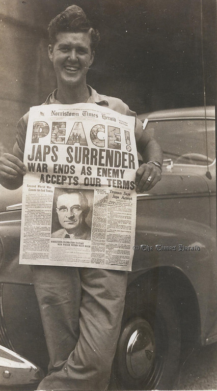 . This Times Herald file photo shows a local resident holding The Times Herald in 1945 when World War II ended with the surrender of Japan.
