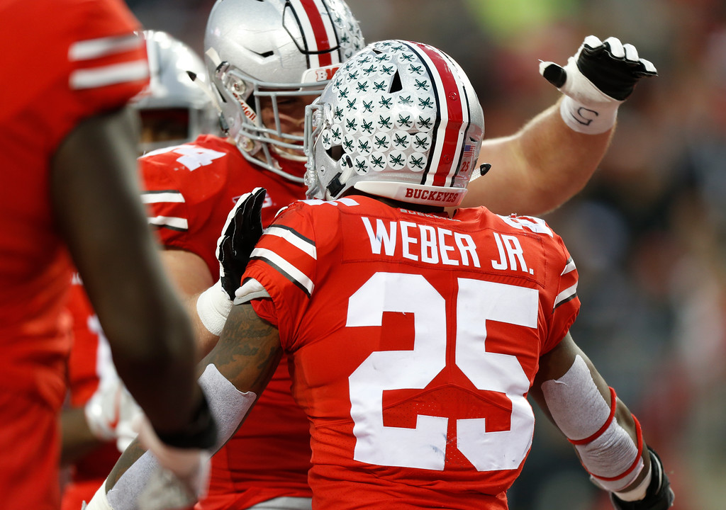 . Ohio State running back Mike Weber, front, celebrates his touchdown against Illinois with teammate Billy Price during the first half of an NCAA college football game Saturday, Nov. 18, 2017, in Columbus, Ohio. (AP Photo/Jay LaPrete)
